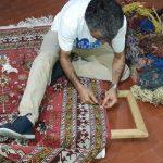 riparazione buco con rimessa in telaio del tappeto